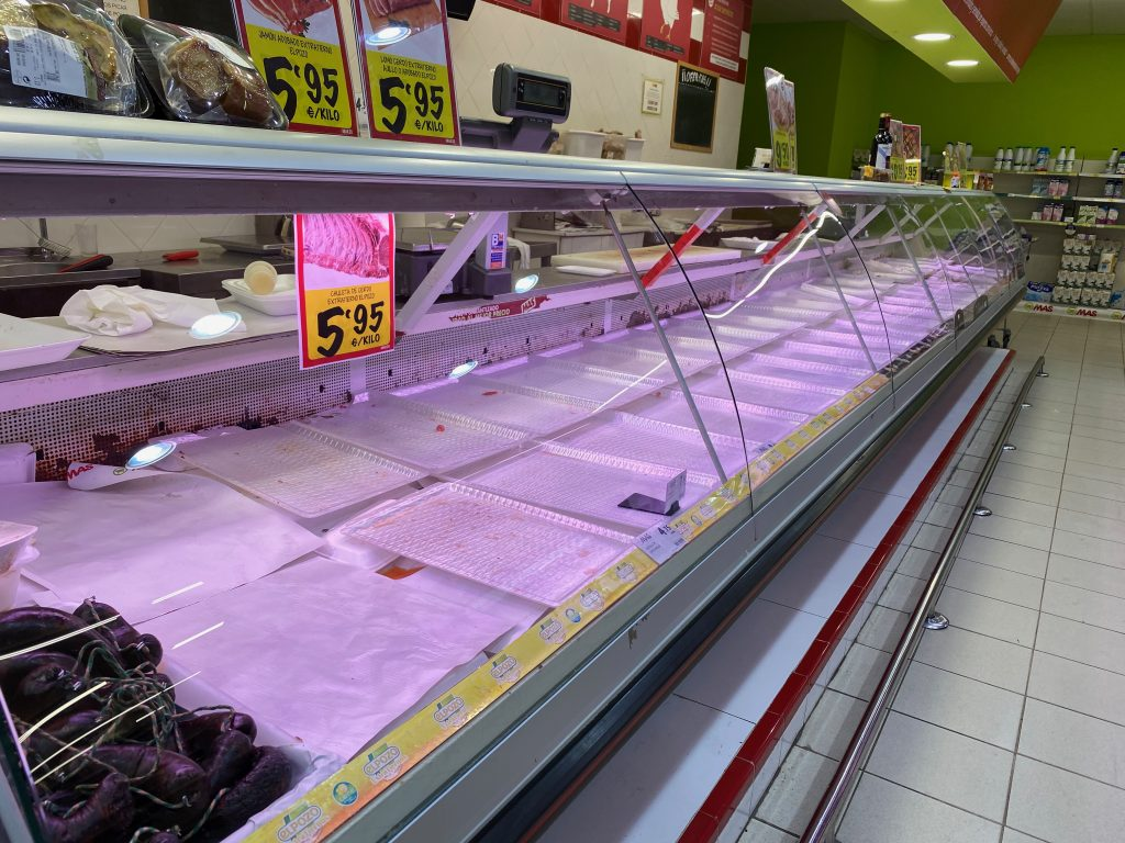 Empty meat counter shelves